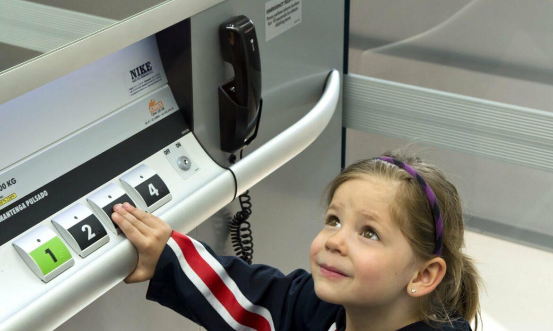 Child in platform lift in school