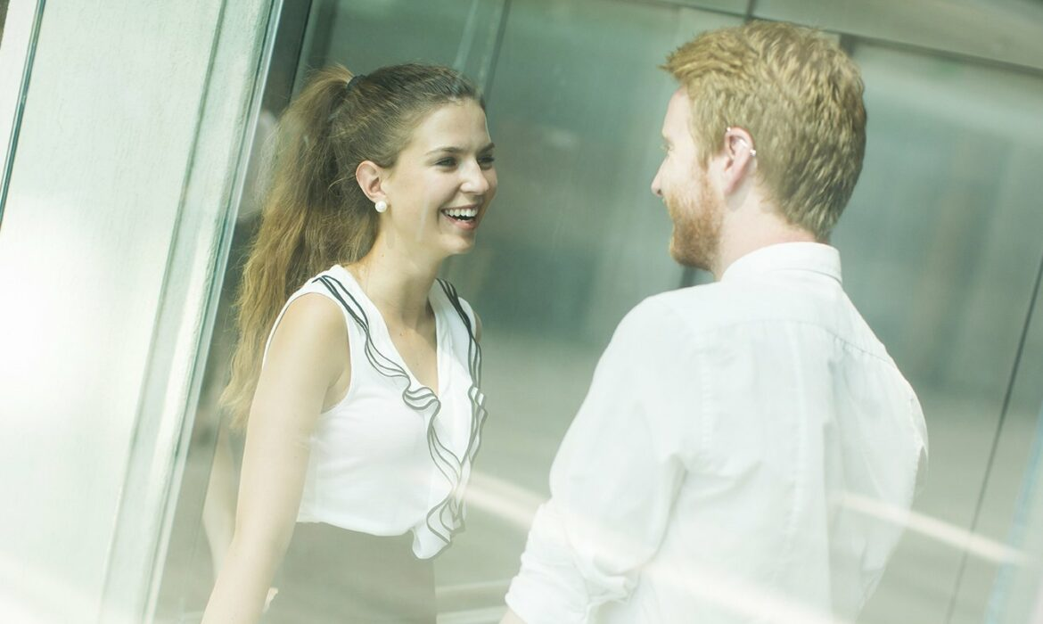 Couple laughing in lift