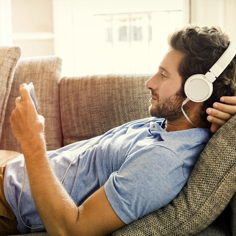 Man watching screen with headphones