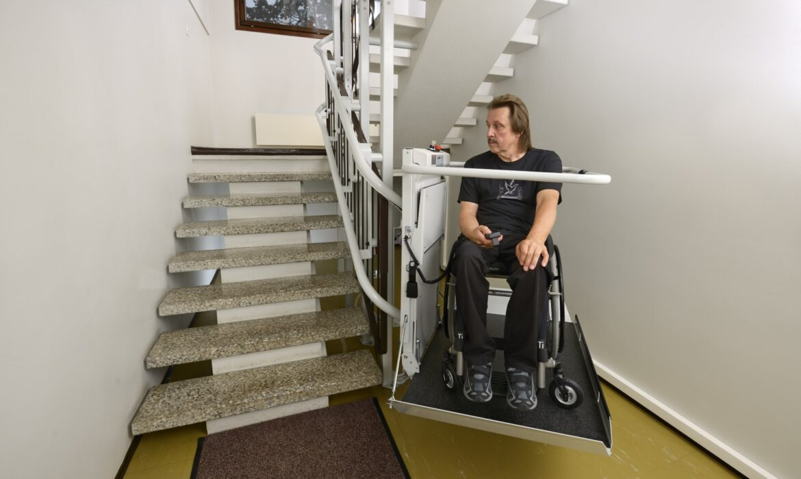 Man using wheelchair accessible lift
