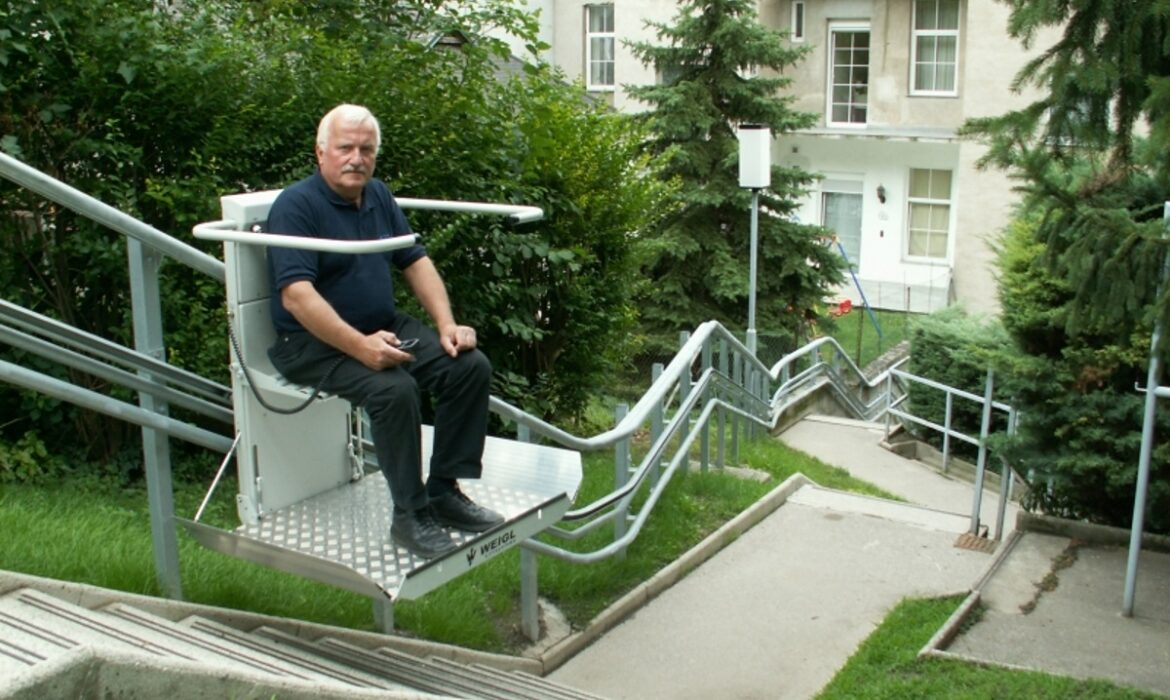 Man using outdoor accessibility lift