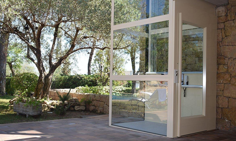 Light beige outdoor lift at private villa