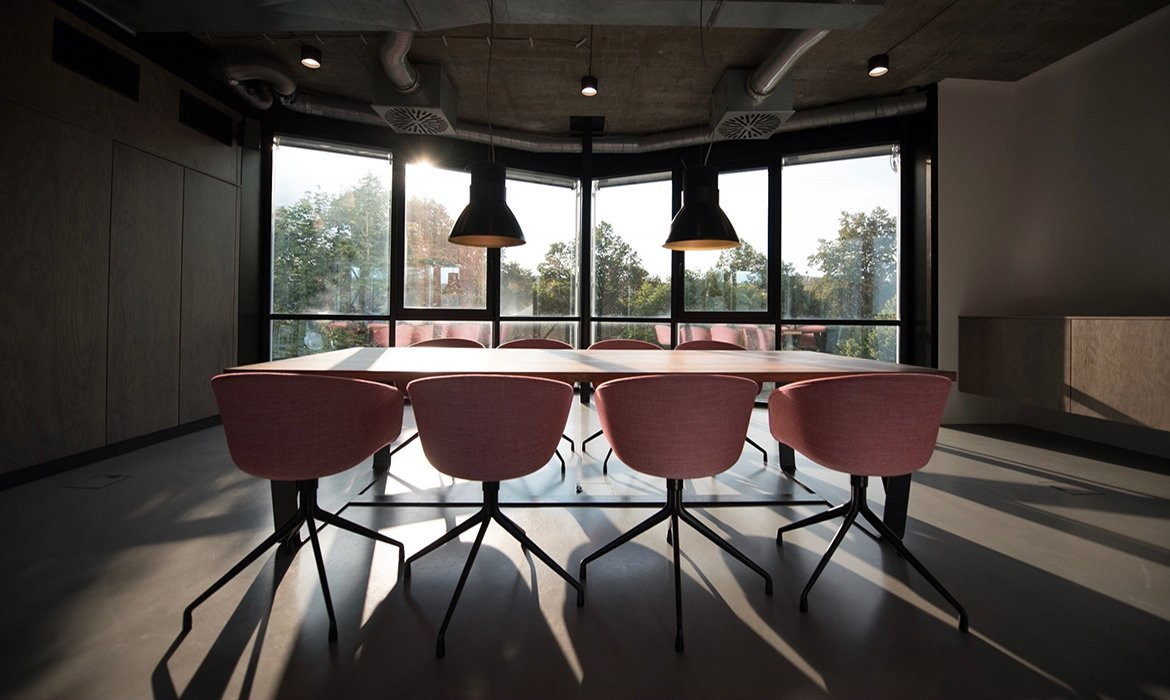 Conference room with grey concrete walls and floors
