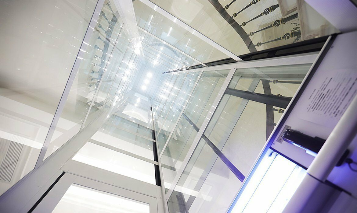 Domestic lift in curved staircase