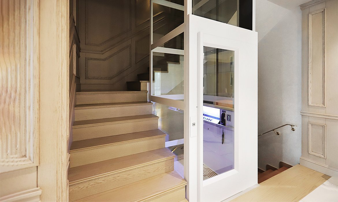Home lift in a staircase