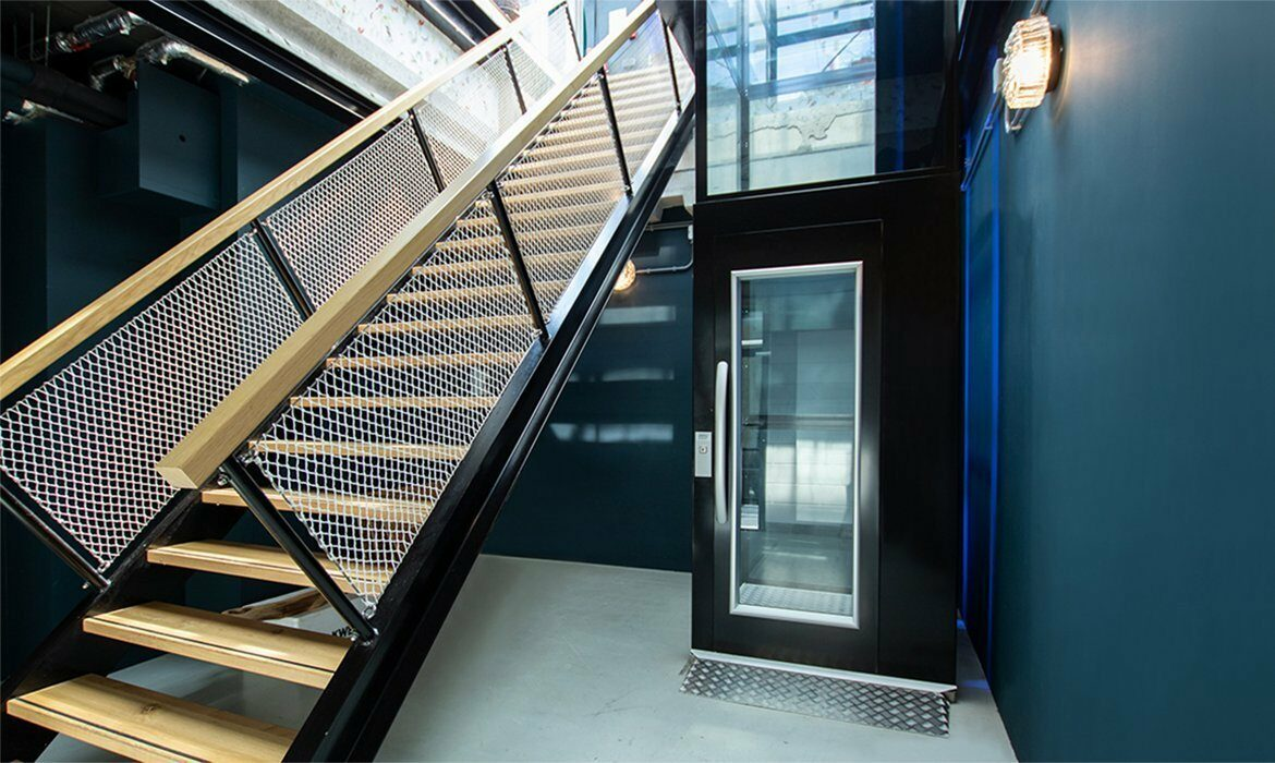 Platform lift placed next to a staircase