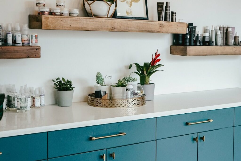 A Kitchen With Blue Cupboards
