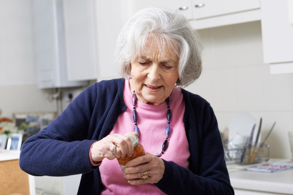 Elderly Woman Opening Jar