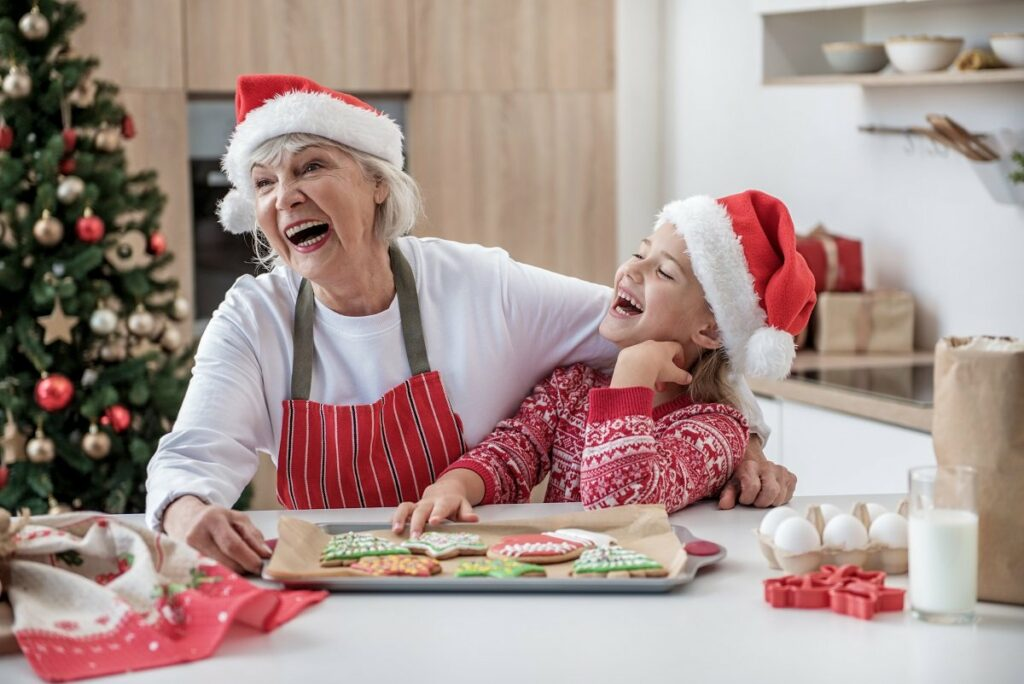 Grandmother And Child Baking At Christmas