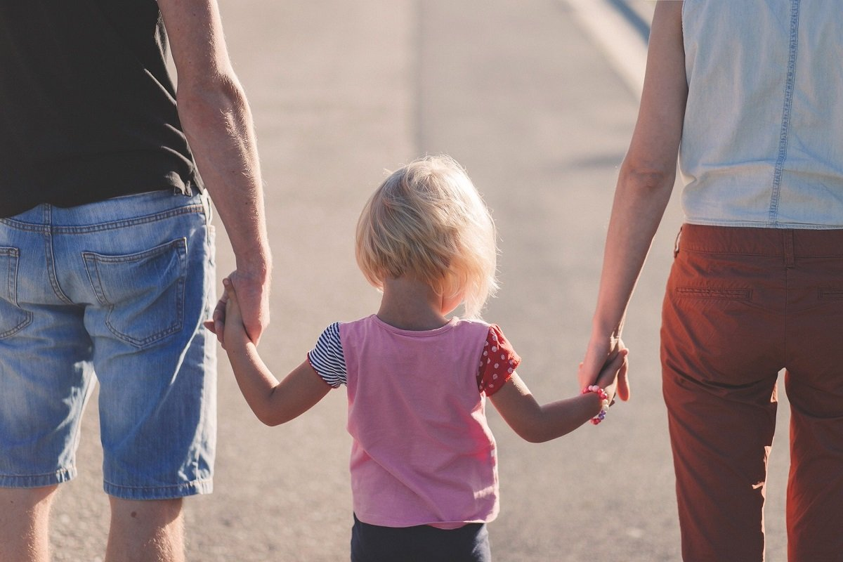 Parents And Child Holding Hands