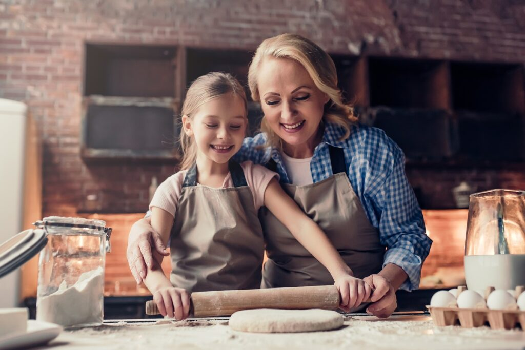 Grandmother Baking With Grandchild