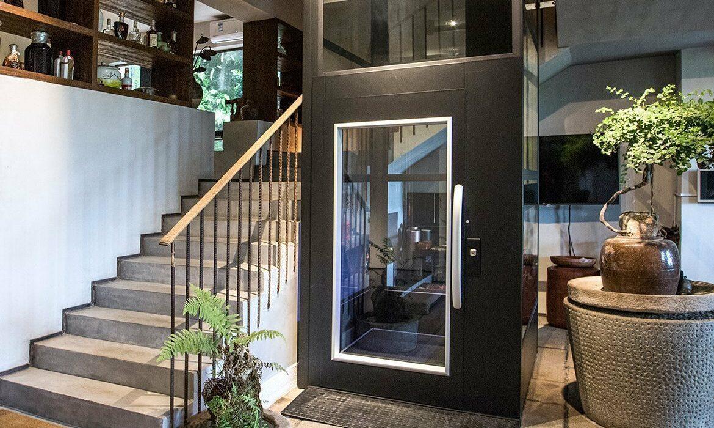 Black platform lift in shop with tiled floor