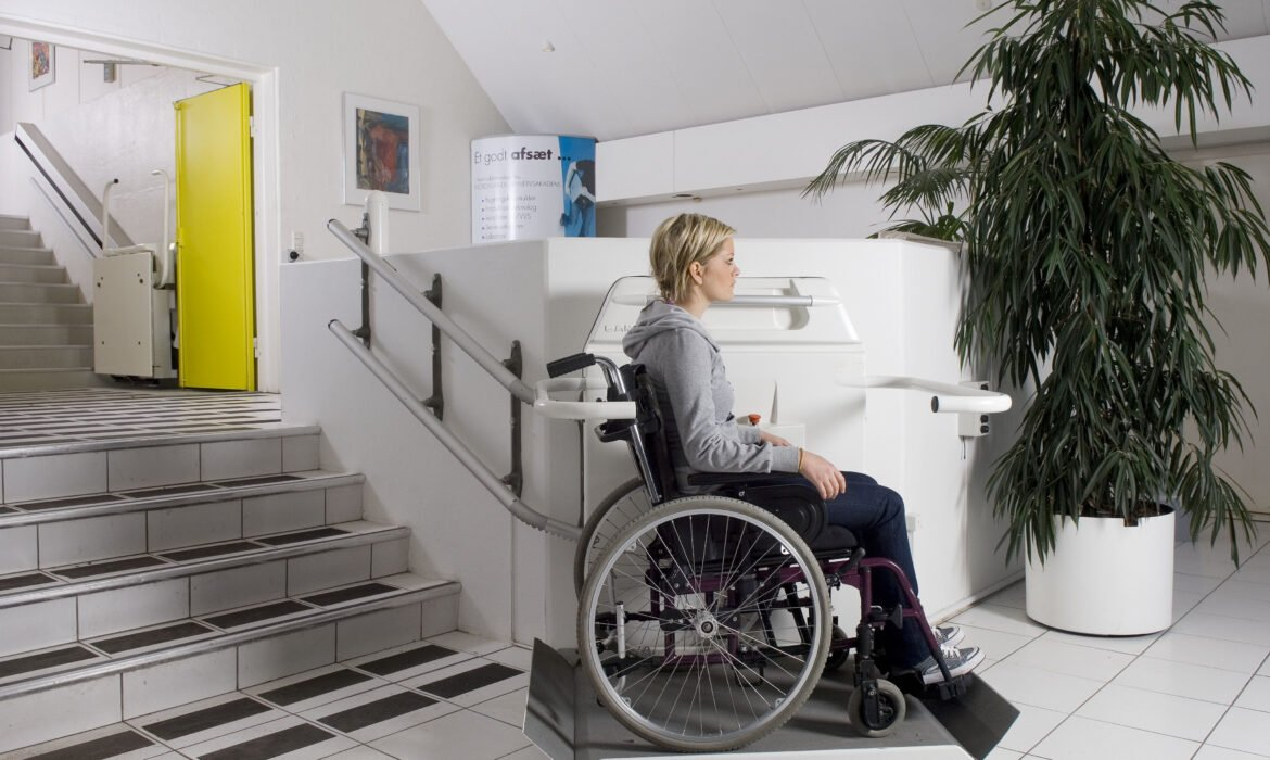 Woman in a wheelchair using a Cibes S6 Stairlift