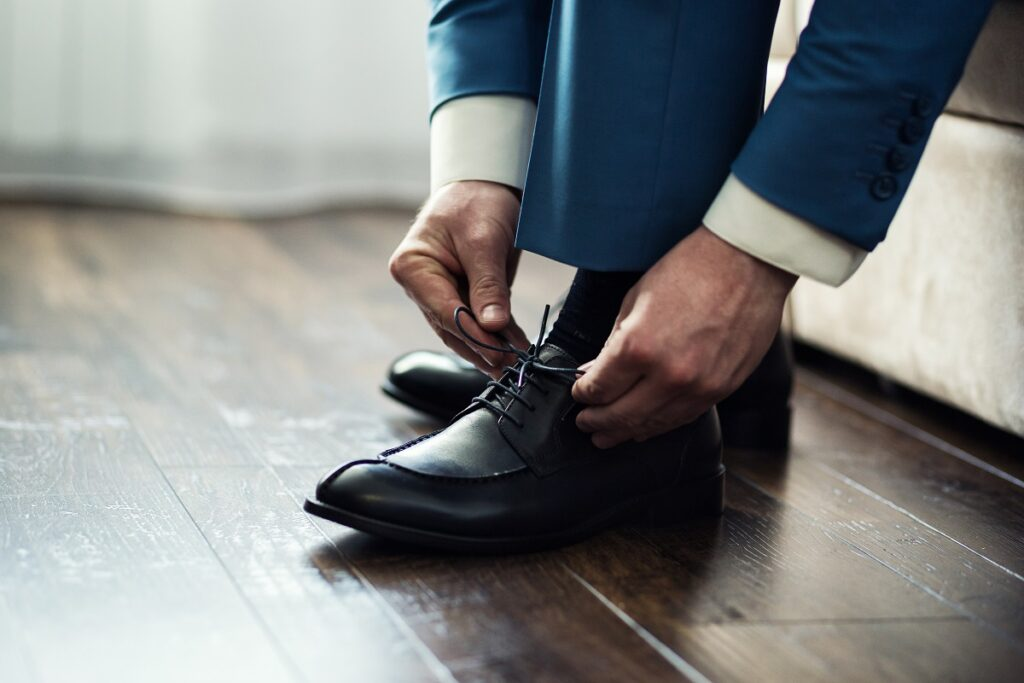 Man Putting On Shoes