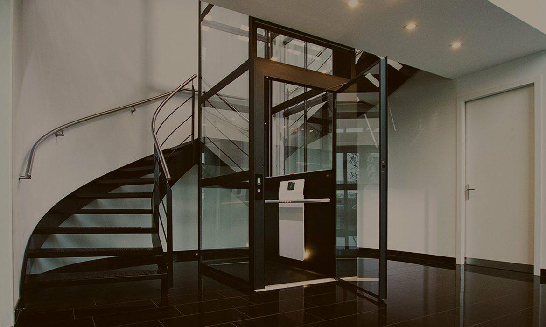 Glazed lift shaft and doors