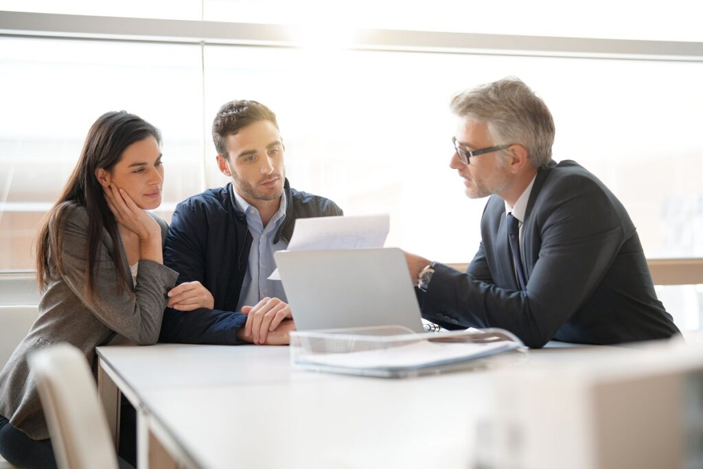 Couple talking to financial planner