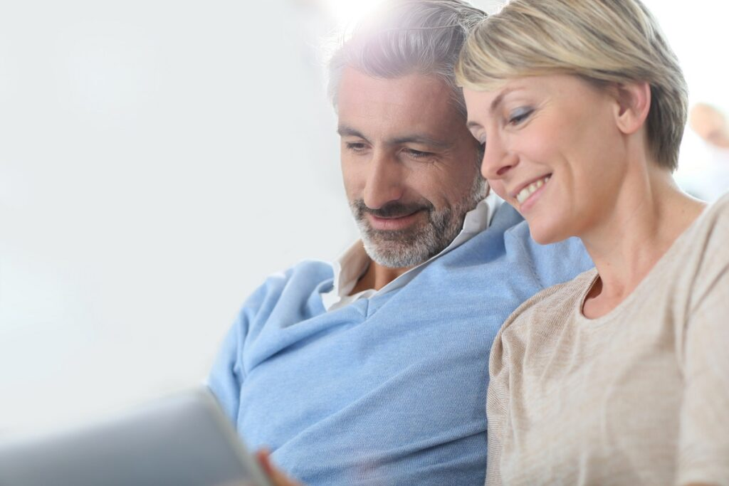 middle age couple looking at tablet