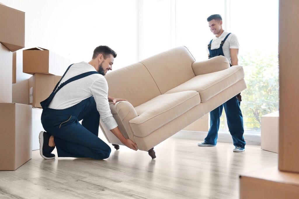 moving men lifting sofa
