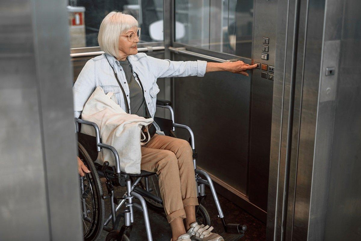Wheelchair user in lift