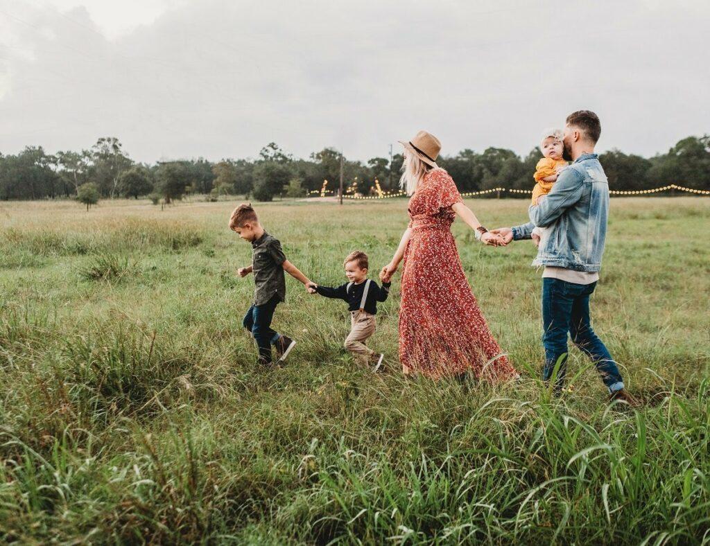 Family Outside In Field