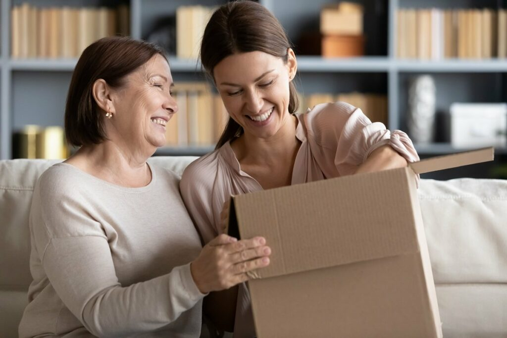 Mother and daughter opening package