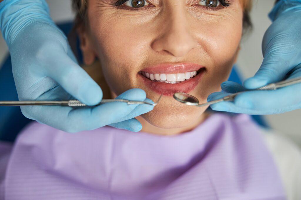 Happy women in dentist chair