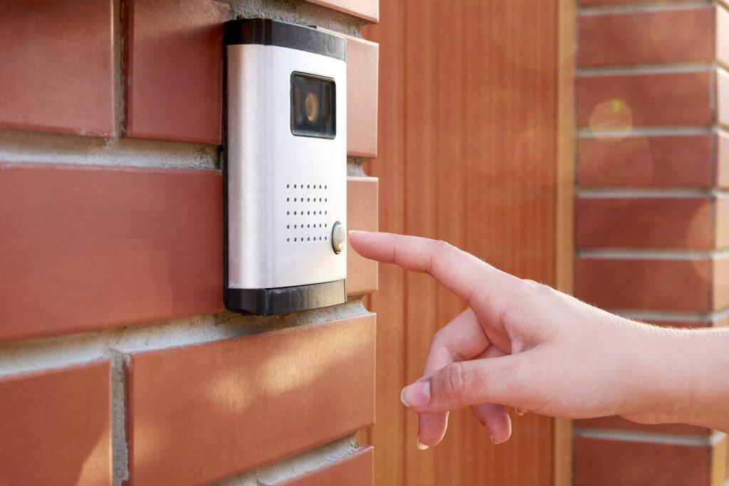 Pressing buzzer on doorbell with camera