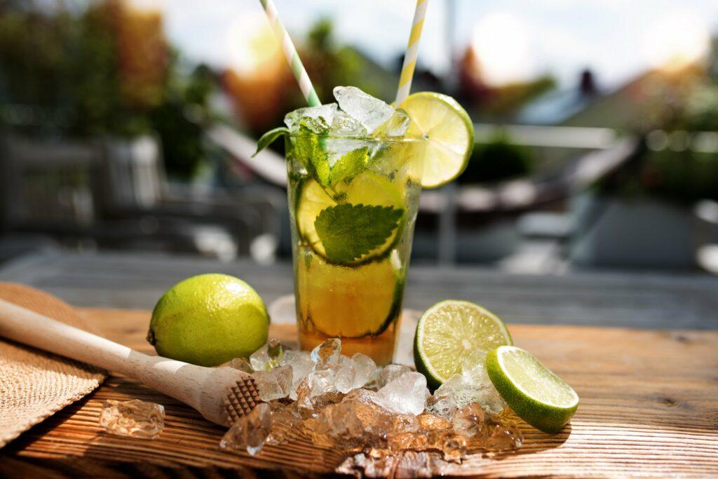 Cocktail on wooden garden bar in sunshine