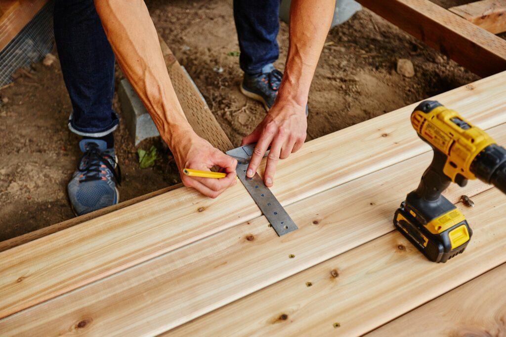 Handyman building garden bar from wood
