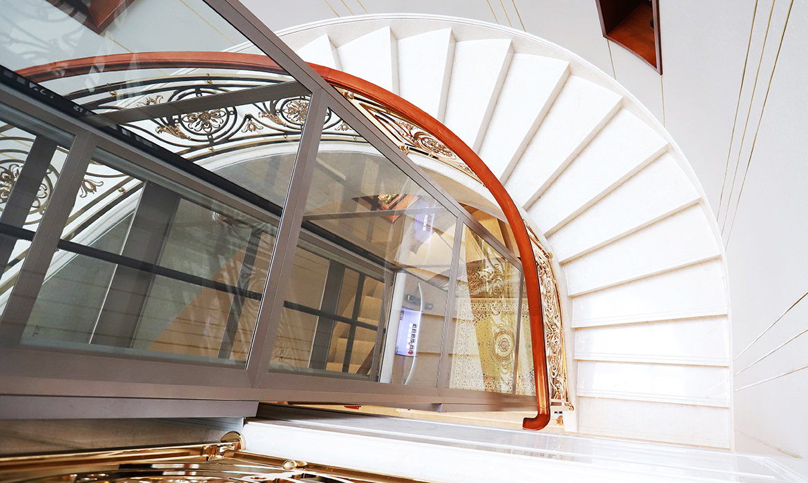 Lift installed inside curved staircase